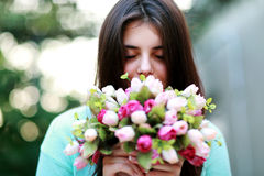 Beautiful woman smelling flowers Royalty Free Stock Photos