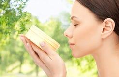 Beautiful woman smelling moisturizing cream aroma stock photos