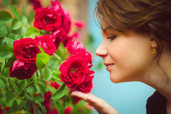 Beautiful woman smelling red roses Royalty Free Stock Photo