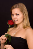 Beautiful woman smelling roses Royalty Free Stock Photo