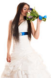 Beautiful woman smelling a wedding bouquet Stock Photography