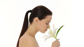 Beautiful woman smelling white flower. stock footage