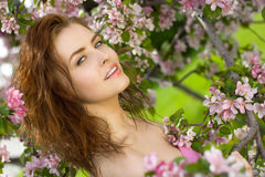 Beautiful woman smile in blossom orchard Royalty Free Stock Photo