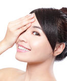 Beautiful woman smile face with clean face skin. And hand cover her eyes , concept for eye and skin care, isolated over white background, asian beauty Royalty Free Stock Photography