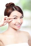 Beautiful woman smile face and finger touch her eyes Royalty Free Stock Photo