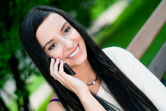 Beautiful woman smile. In the park Stock Photography