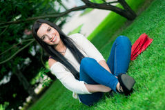 Beautiful woman smile. In the park Stock Image