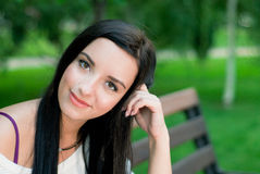 Beautiful woman smile. In the park Stock Photos