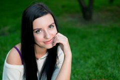Beautiful woman smile. In the park Royalty Free Stock Photography