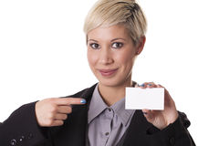 Beautiful woman smiles with a blank business card. Royalty Free Stock Image