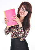 Beautiful woman smiles and shows the book Royalty Free Stock Photo