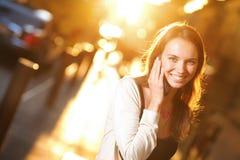 Beautiful woman smiling. Talking on phone stock image