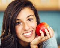 Beautiful woman smiling with apple stock images