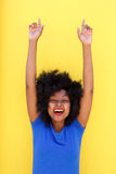 Beautiful woman smiling with arms raised Royalty Free Stock Image