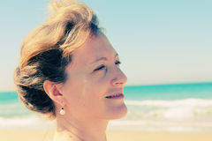 Beautiful woman smiling on the beach Royalty Free Stock Photography