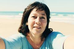 Beautiful woman smiling on the beach Stock Photo