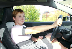 Beautiful woman with smiling behind the wheel Royalty Free Stock Images
