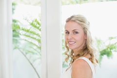 Beautiful woman smiling at camera. In the bathroom Royalty Free Stock Image