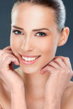 Beautiful woman smiling, close up. Over a dark background royalty free stock images