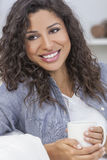 Beautiful Woman Smiling Drinking Tea or Coffee Stock Photos