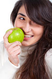 Beautiful woman smiling with a green apple on hands Royalty Free Stock Photo