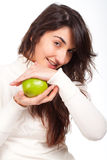 Beautiful woman smiling with a green apple on hands Royalty Free Stock Image