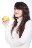 Beautiful woman smiling with a green apple on hands Stock Photography