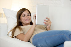 Beautiful woman smiling happy working at home with digital tablet computer pad Royalty Free Stock Photos
