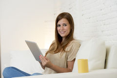 Beautiful woman smiling happy working at home with digital tablet computer pad Royalty Free Stock Image