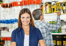 Beautiful Woman Smiling In Hardware Store Royalty Free Stock Photo