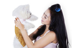 Beautiful woman smiling with her dog on studio Royalty Free Stock Photo