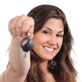 Beautiful woman smiling and holding her car key. Isolated on a white background Stock Photo