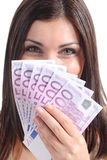 Beautiful woman smiling and holding a lot of five hundred euro banknotes. Isolated on a white background Royalty Free Stock Photo