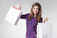 Beautiful woman smiling holding shopping bags Stock Images