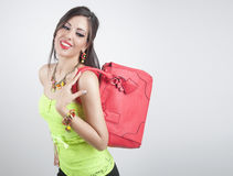 Beautiful woman smiling with jewelry and bag Stock Photos