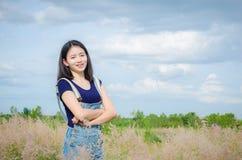 Beautiful woman smiling in meadow Stock Image