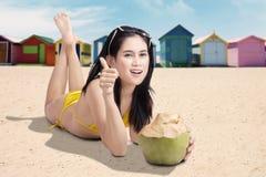 Beautiful woman smiling with ok thumb Stock Photo
