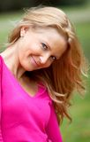 Beautiful woman smiling outdoors Royalty Free Stock Images