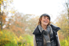 Beautiful Woman Smiling in the Park Stock Images