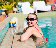 Beautiful  woman smiling in a pool Royalty Free Stock Photography