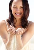 Beautiful woman smiling with sand in hands Stock Photos
