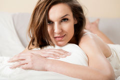 Beautiful woman smiling seductively in bed Stock Images
