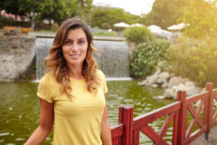 Beautiful woman smiling while standing near lake Stock Image