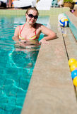 Beautiful  woman smiling in a swimming pool Royalty Free Stock Images