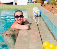 Beautiful  woman smiling in a swimming pool Stock Images