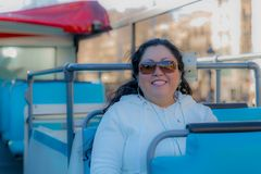 Beautiful woman smiling in a touristic bus enjoying the city. Wonderful and sunny day to enjoy the city in Barcelona Spain, concept of travel and adventure stock photos