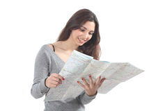 Beautiful woman smiling and watching a road map. On a white isolated background Royalty Free Stock Photography