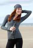 Beautiful woman smiling with water bottle outdoors Royalty Free Stock Images