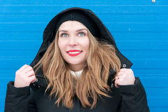 Beautiful woman smiling wearing hood and winter clothes Royalty Free Stock Photography