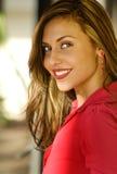 Beautiful woman smiling wearing red Stock Image